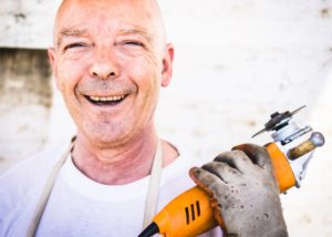 Tax rebate by Christmas - man with angle grinder
