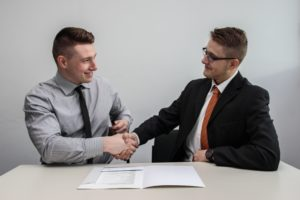 Selling Your Business: image of two men shaking on a deal