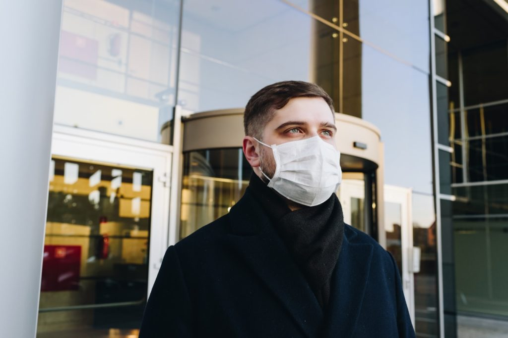 borrow cash from your business - businessman wearing face mask