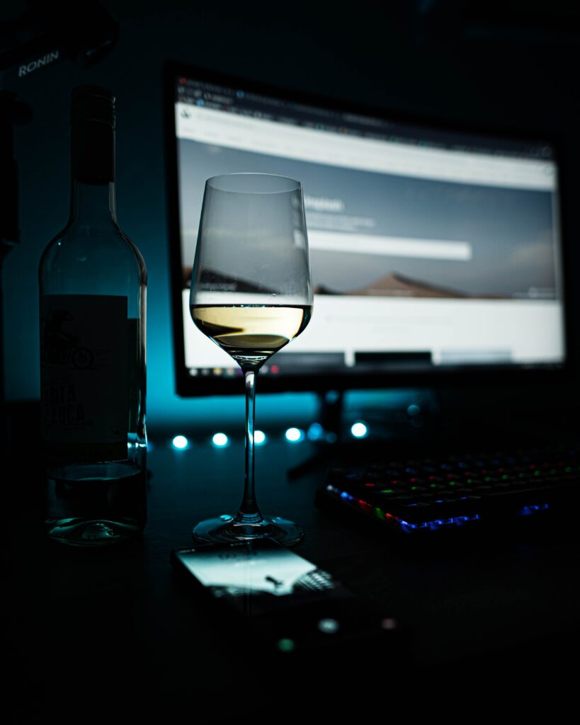 Virtual Christmas Party - glass of wine and computer
