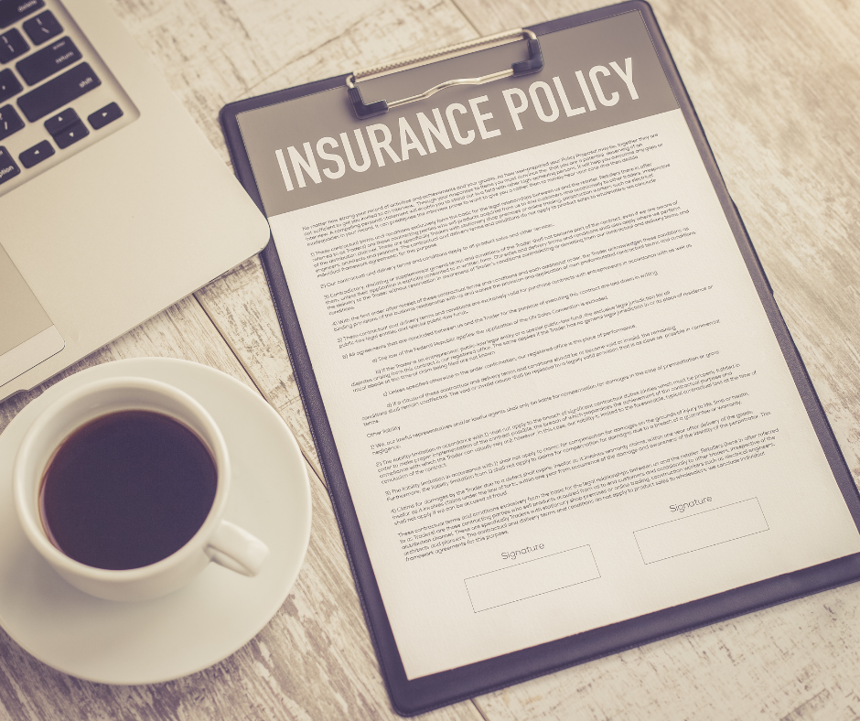 Business insurance policies - a policy document on a desk