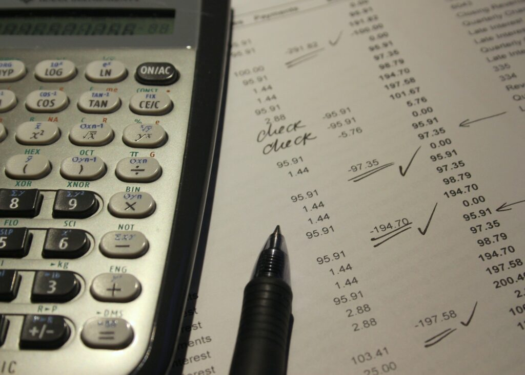 What is the deadline for P11Ds? A calculator and a pen are placed on a document used to calculate tax.